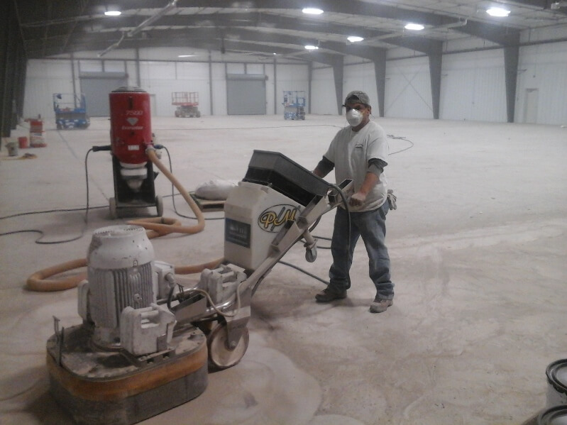 Diamond grinding industrial concrete floor before sealing