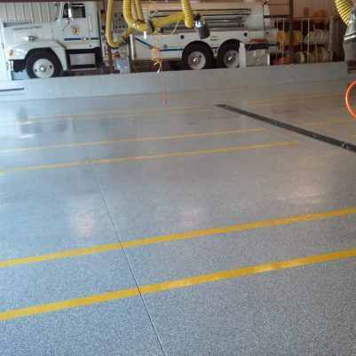 Industrial Concrete Floor Coating - Polyaspartic Polyurea coating with flakes and clear coat and safety lines