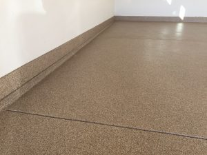 Garage Floor with Baseboard Installed and coated with epoxy