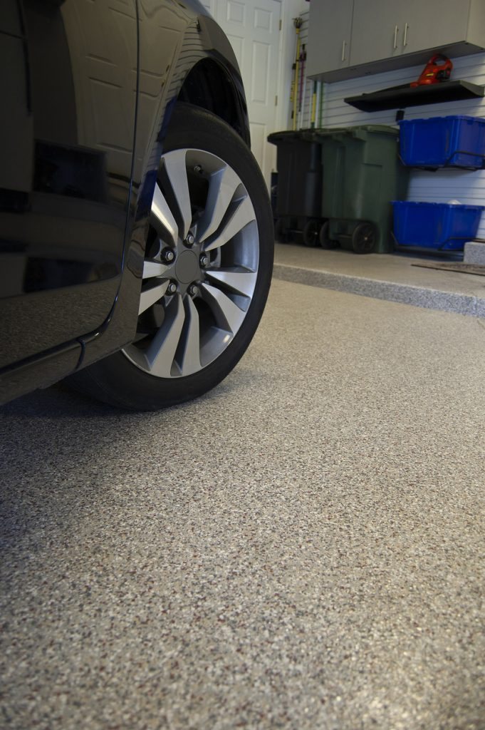 An epoxy coating or concrete staining on garage floor.