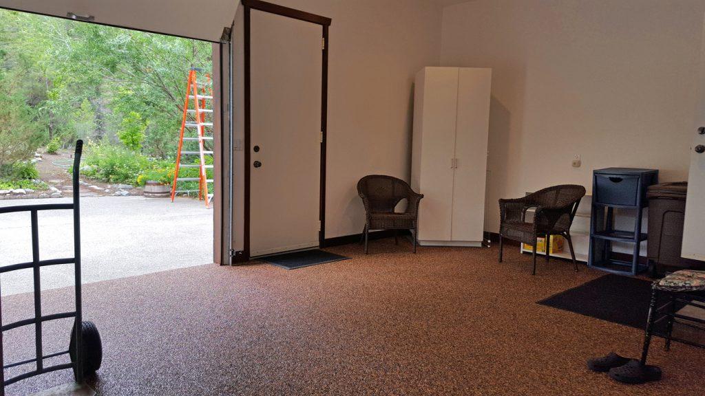 A garage with a new garage floor coating (epoxy).