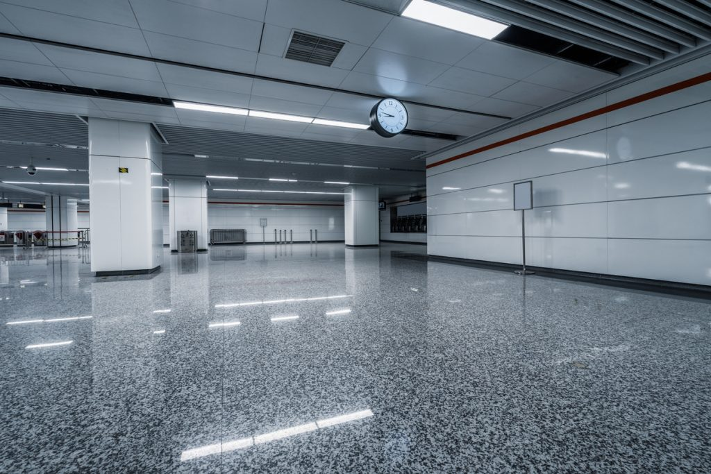 A modern garage interior with a garage floor coating reflecting the lights.